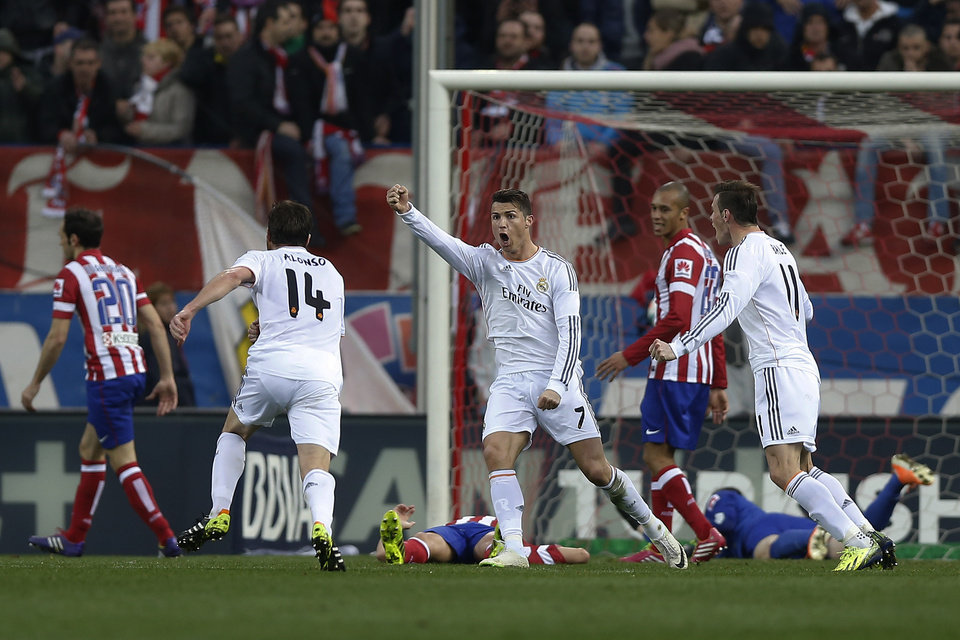 Photo - Real's Cristiano Ronaldo, centre, celebrates his goal during a Spanish La Liga soccer match between Atletico de Madrid and Real Madrid at the Vicente Calderon stadium in Madrid, Spain, Sunday, March 2, 2014. (AP Photo/Andres Kudacki)