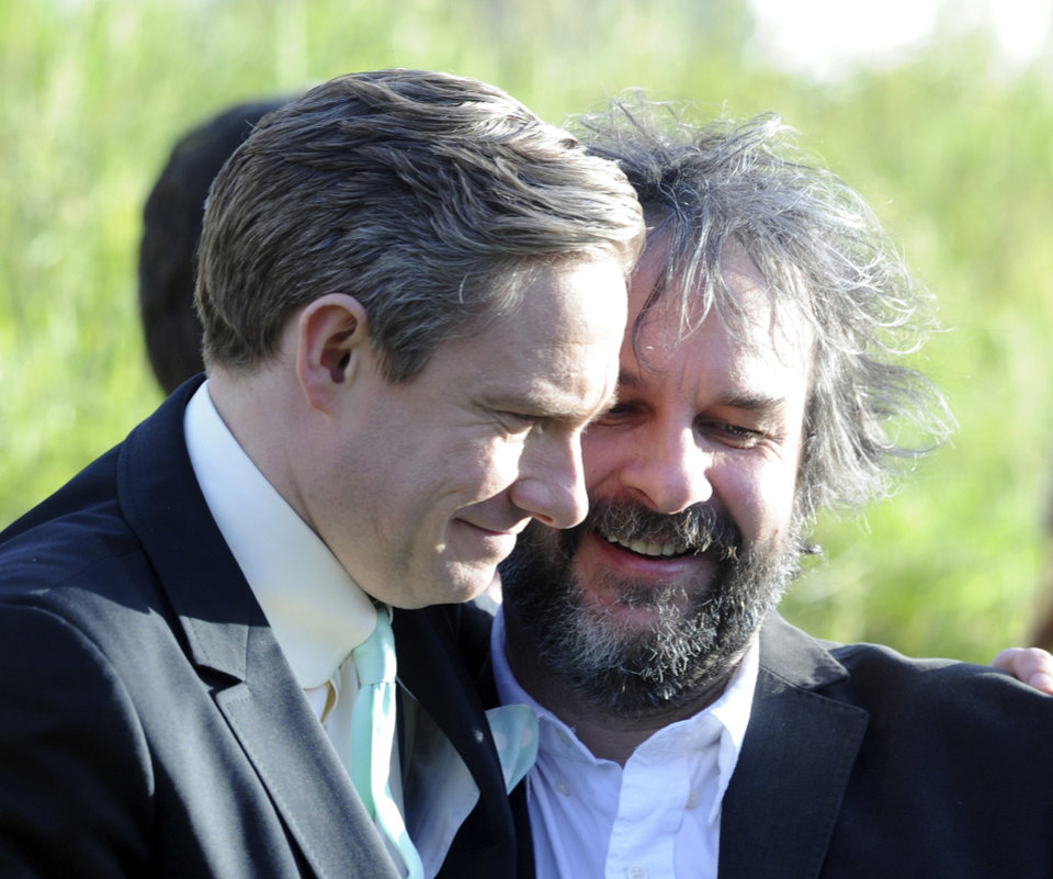 Photo -   Cast member Martin Freeman, left, embraces director Peter Jackson at the premiere of
