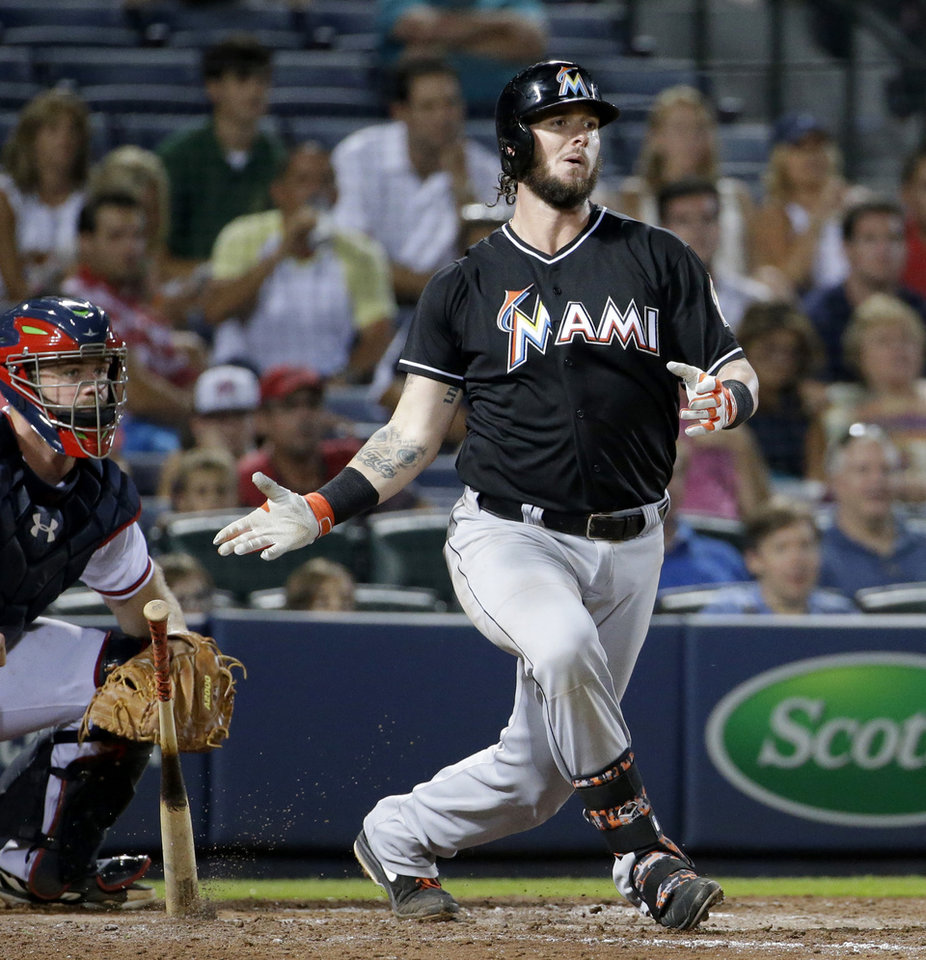Photo - Miami Marlins catcher Jarrod Saltalamacchia grounds into a double play in the ninth inning of a baseball game against the Atlanta Braves, Friday, Aug. 29, 2014, in Atlanta. Atlanta won 5-2. (AP Photo/David Goldman)