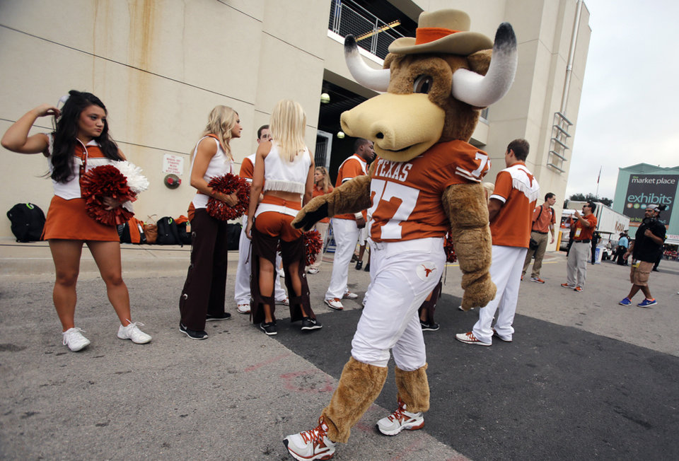 The Texas mascot Hook'em prepares for the team to arrive during the Red River Rivalry college football game between the University of Oklahoma Sooners (OU) and the University of Texas Longhorns (UT) at the Cotton Bowl Stadium in Dallas, Saturday, Oct. 12, 2013. Photo by Chris Landsberger, The Oklahoman