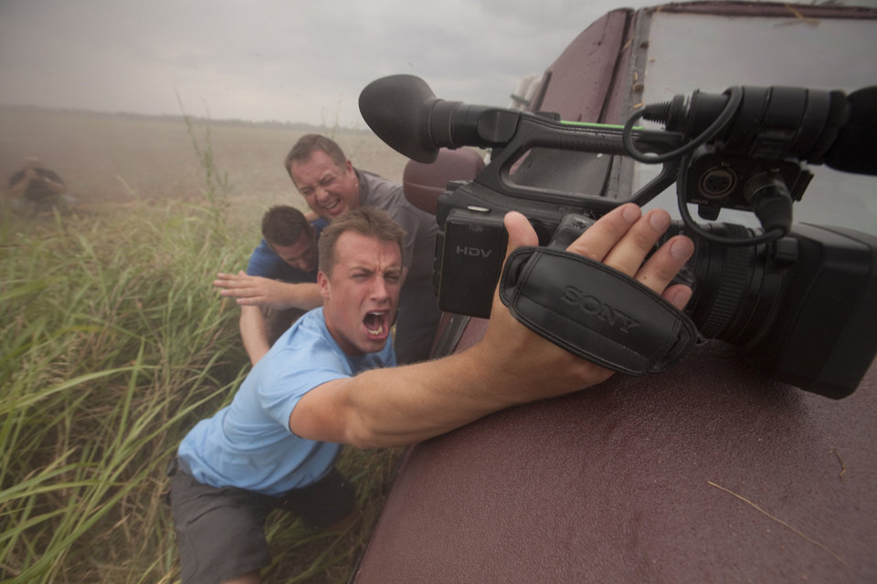 "From top, Chris Chittick, Joel Taylor and Reed Timmer are shown in this publicity shot for ""Storm Chasers,"" which returns for a fourth season at 9 tonight on the Discovery Channel. PHOTO PROVIDED"