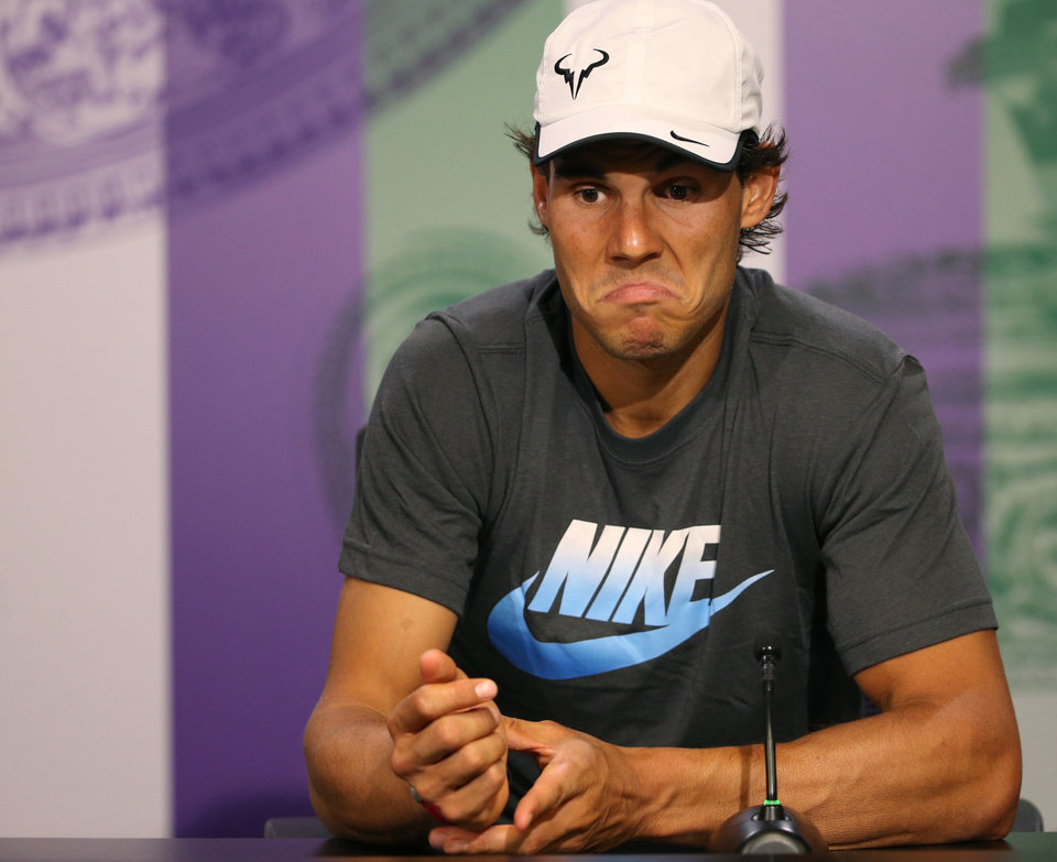Photo - Rafael Nadal of Spain attends a press conference after being defeated by Nick Kyrgios of Australia at the All England Lawn Tennis Championships in Wimbledon, London, Tuesday July 1, 2014. (AP Photo/AELTC, Scott Heavey)