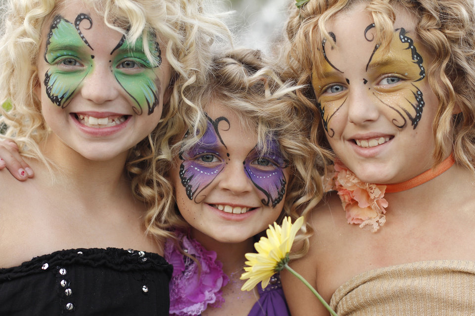 Photo -  Sisters from left, Emily Blackburn, 10, Anna Blackburn, 9, and Raven Buchanan, 10, show off their face paint during the Fairy Ball in the Paseo Saturday, September 24, 2011. Photo by Doug Hoke, The Oklahoman. ORG XMIT: KOD  Doug Hoke - THE OKLAHOMAN