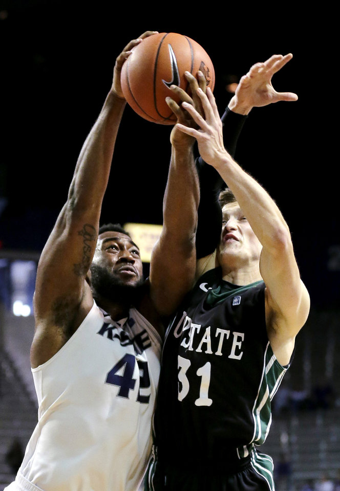 Photo - Kansas State forward Thomas Gipson (42) grabs a loose ball against South Carolina Upstate guard Mario Blessing (31) during the second half of an NCAA college basketball game, Sunday, Dec. 2, 2012, in Manhattan, Kan. Kansas State won 72-53. (AP Photo/Charlie Riedel)