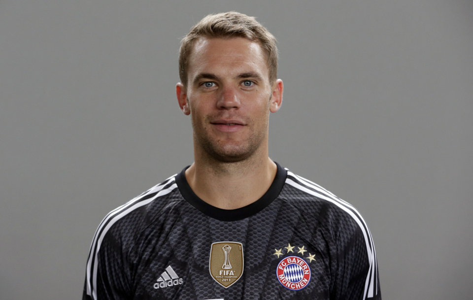 Photo - In this picture taken Saturday, Aug. 9, 2014, Bayern Munich's Manuel Neuer poses during an official photo shooting for the new German first division Bundesliga soccer season in Munich, southern Germany. World Cup-winning goalkeeper Neuer has been named Germany's footballer of the year in an annual poll of sports journalists. Kicker magazine said Sunday, Aug. 10, 2014, that the Bayern Munich keeper received 144 out of 701 votes in its poll. He finished nine votes ahead of Borussia Dortmund forward Marco Reus, who missed the World Cup because of a knee injury suffered in Germany's final warm-up match. (AP Photo/Matthias Schrader)