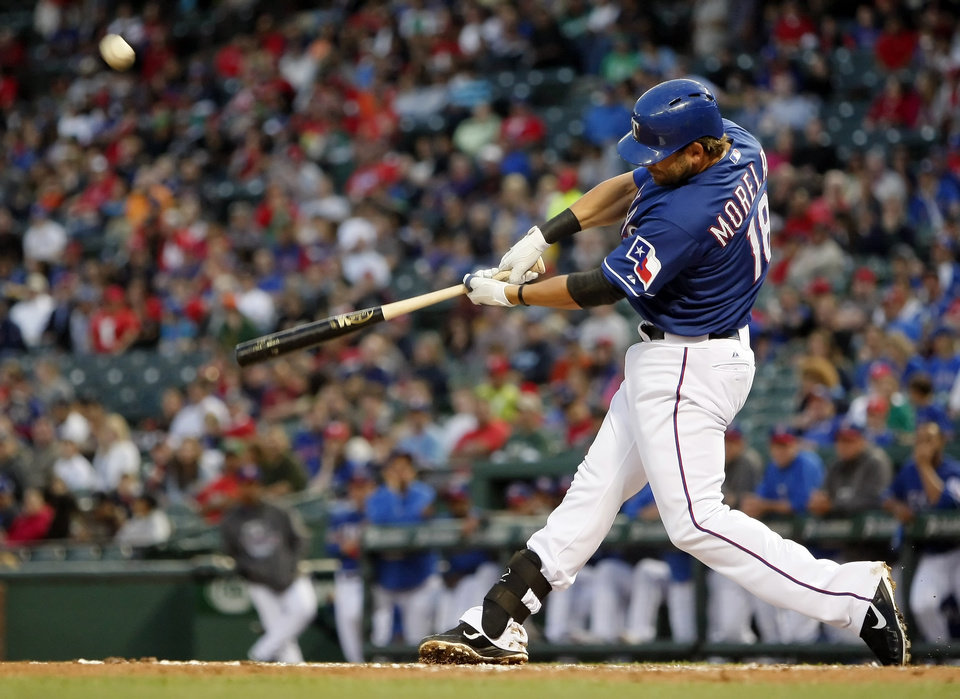 Texas Rangers' Mitch Moreland (18) flies out against the Mexico City Red Devils during the second inning of a spring training exhibition baseball game, Thursday, March 28, 2013, in Arlington, Texas. (AP Photo/The Fort Worth Star-Telegram, Brandon Wade)  MAGS OUT; (FORT WORTH WEEKLY, 360 WEST); INTERNET OUT