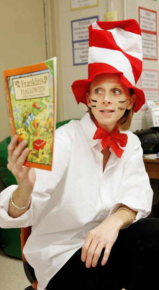 Photo - Prekindergarten teacher Amy Ohlheiser reads a Halloween story to her class while dressed as the Cat in the Hat at Hayes Elementary in Oklahoma City on Wednesday.  PAUL B. SOUTHERLAND - PAUL B. SOUTHERLAND