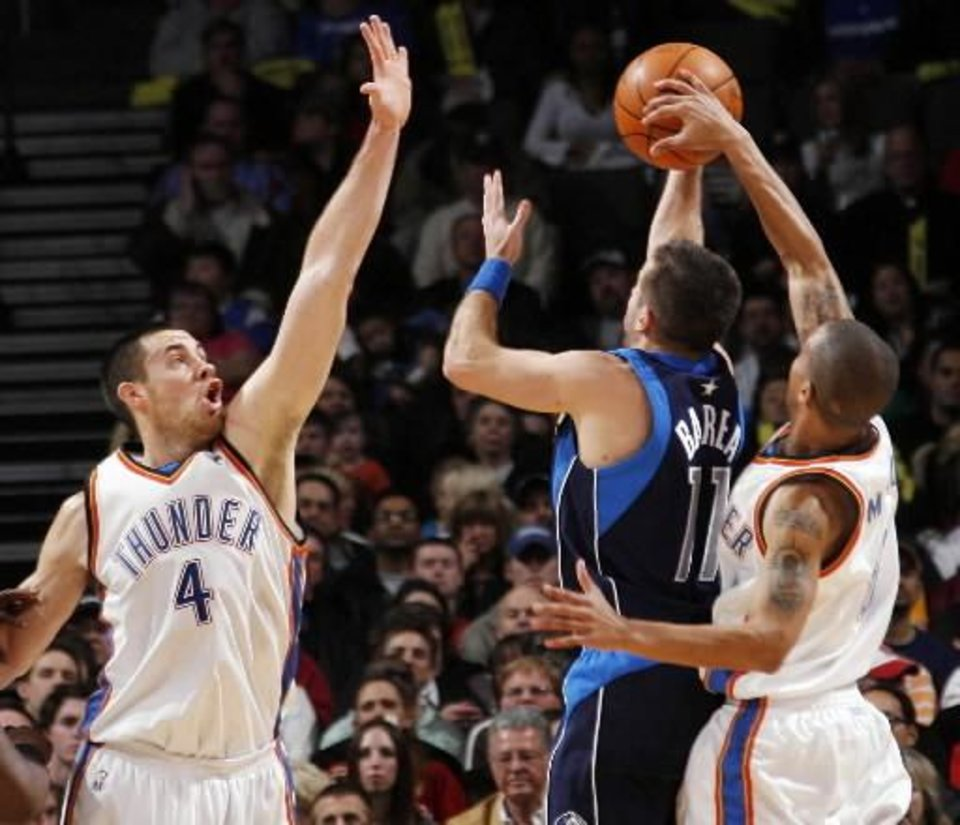 Eric Maynor (6) of Oklahoma City blocks the shot of Jose Barea (11) of Dallas as  Nick  Collison (4) of Oklahoma City defends during the NBA basketball game between the Dallas Mavericks and the Oklahoma City Thunder at the Ford Center in Oklahoma City, Tuesday, Feb. 16, 2010. Photo by Nate Billings