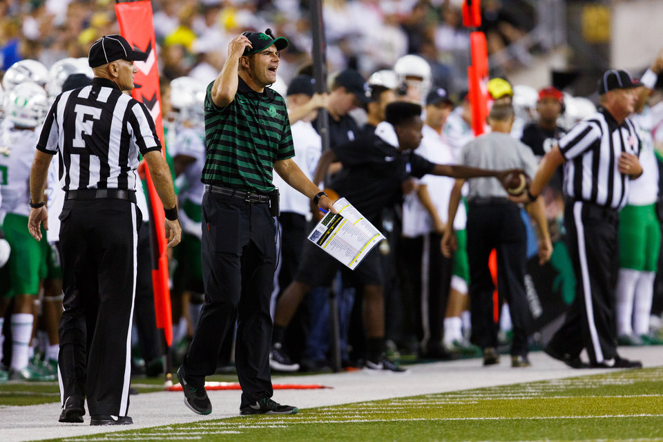 Photo - Oregon coach Mark Helfrich yells during the first quarter of an NCAA college football game against South Dakota in Eugene, Ore., Saturday, Aug. 30, 2014. (AP Photo/Ryan Kang)