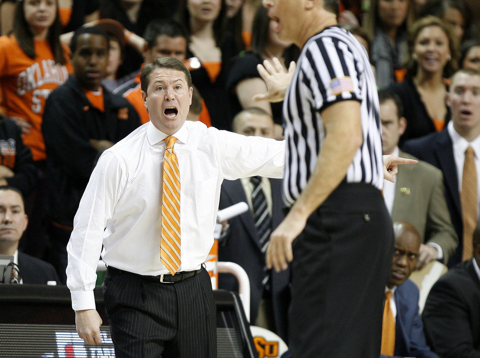 Photo - OSU coach Travis Ford reacts after a call during the Bedlam men's college basketball game between the University of Oklahoma Sooners and Oklahoma State University Cowboys at Gallagher-Iba Arena in Stillwater, Okla., Saturday, February, 5, 2011. Photo by Bryan Terry, The Oklahoman