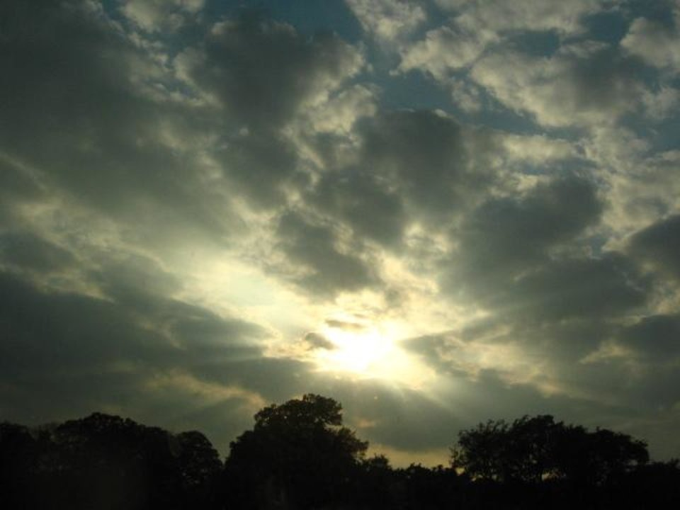 The sun shining through the clouds during one of the brief breaks from the rain.<br/><b>Community Photo By:</b> Cory Cannon<br/><b>Submitted By:</b> Cory, Warr Acres
