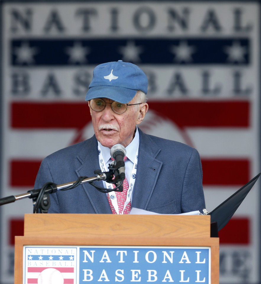 Photo - Roger Angell of The New Yorker speaks after receiving the J.G. Taylor Spink Award during a ceremony at Doubleday Field on Saturday, July 26, 2014, in Cooperstown, N.Y.  (AP Photo/Mike Groll)