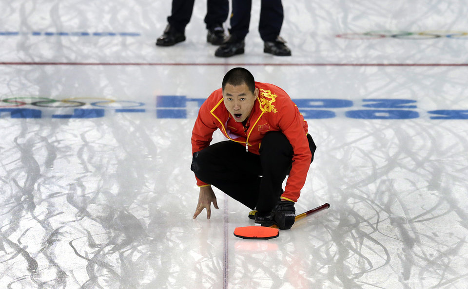 Photo - China's skip Liu Rui shouts instructions to his teammates during the men's curling bronze medal game against Sweden at the 2014 Winter Olympics, Friday, Feb. 21, 2014, in Sochi, Russia. (AP Photo/Wong Maye-E)