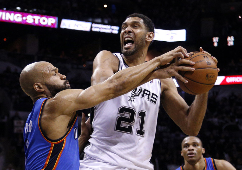 Photo - Oklahoma City's Derek Fisher (6) defends against San Antonio's Tim Duncan (21) during Game 1 of the Western Conference Finals in the NBA playoffs between the Oklahoma City Thunder and the San Antonio Spurs at the AT&T Center in San Antonio, Monday, May 19, 2014. Photo by Sarah Phipps, The Oklahoman