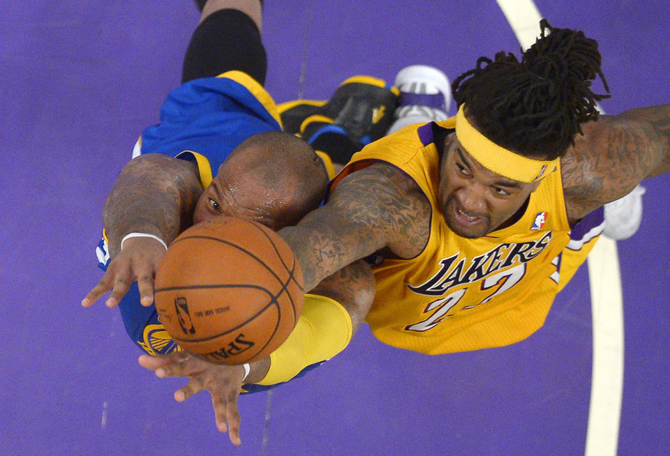 Photo - Golden State Warriors forward Marreese Speights, left, and Los Angeles Lakers forward Jordan Hill reach for a rebound during the first half of an NBA basketball game, Friday, April 11, 2014, in Los Angeles. (AP Photo/Mark J. Terrill)