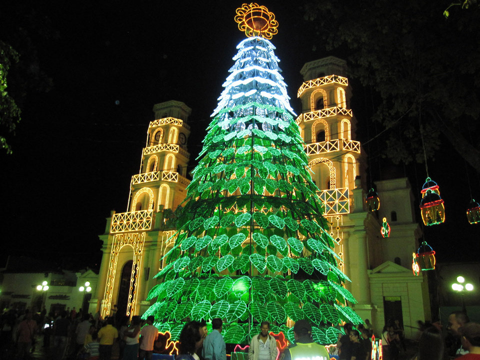 Photo - This Dec. 25, 2013 image shows a display of lights outside a church in Medellin, Colombia, which is famous for its holiday lights. Beth Harpaz and her family saw the lights with a private guide who drove them around the city. Private tours are no longer the exclusive domain of wealthy travels as websites make it easy for tourists and local guides to connect. (AP Photo/Beth Harpaz)