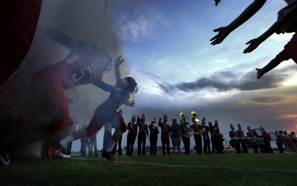 Washington Warriors come on to the field to play the Purcell Dragons in high school football on Friday, Sept. 13, 2013 in Washington, Okla. Photo by Steve Sisney, The Oklahoman