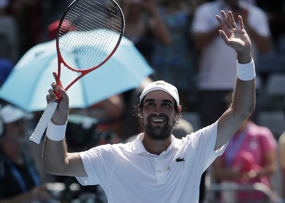 Photo - France's Jeremy Chardy celebrates after winning his fourth round match against Italy's Andreas Seppi at the Australian Open tennis championship in Melbourne, Australia, Monday, Jan. 21, 2013. (AP Photo/Rob Griffith)