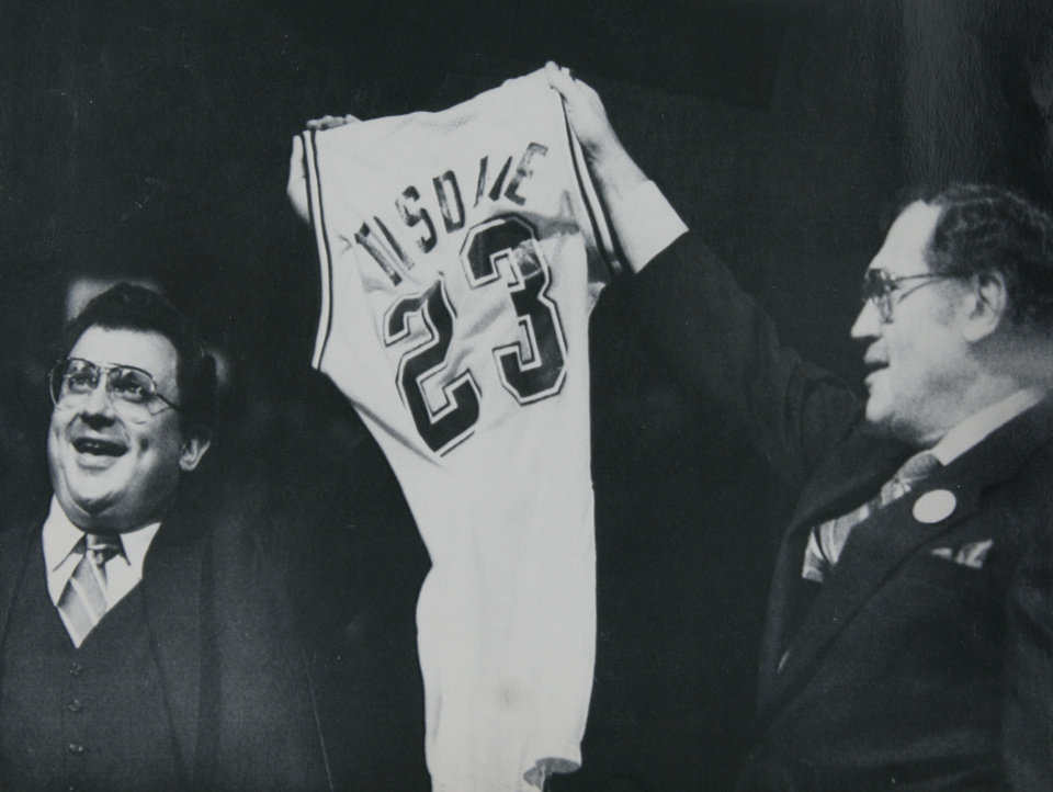 Former OU basketball player Wayman Tisdale. Indianapolis, June 18 -TIS TISDALE - Indiana Pacers owners Herb and Mel Simon (right) hold up the shirt that will be worn by three-time All American Wayman Tisdale-of Oklahoma after he was chosen in the National Basketball Association college player draft. The choice was popular among the 6,000 fans who watched the draft on a large screen. The Pacers took Tisdale after the New York Knicks chose Patrick Ewing as the number one player in the draft. 1985. 6-19-85 ORG XMIT: KOD