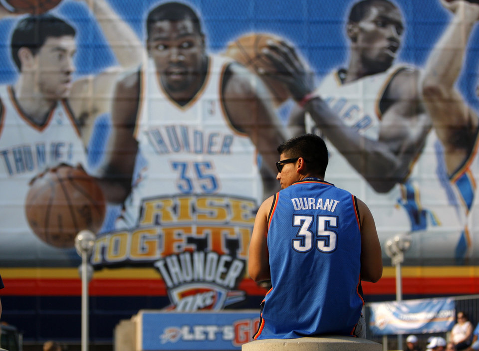 Photo - Jose Hernandez of Oklahoma City waits outside the Oklahoma City Arena before the NBA basketball game between the Denver Nuggets and the Oklahoma City Thunder in the first round of the NBA playoffs at the Oklahoma City Arena, Sunday, April 17, 2011. Photo by Bryan Terry, The Oklahoman