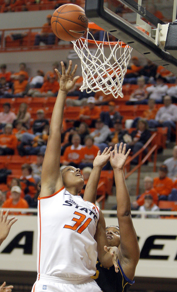 Photo - Oklahoma State's Kendra Suttles (31) shoots over Coppin State's Dawnnae Roberts (32) during the women's college game between Oklahoma State University and Coppin State at Gallagher-Iba Arena in Stillwater, Okla.,  Saturday, Nov. 26, 2011.  Photo by Sarah Phipps, The Oklahoman
