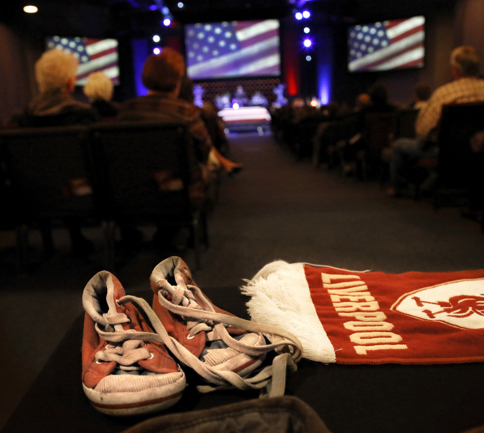 Personal memorabilia, including this pair of boy's small tennis shoes,  from the life of Rex Schad  are spread across this table near the doors to the worship area during Schad's funeral. Celebration of Life service  for US Army SSgt. Rex L. Schad at LifeChurch.tv in Edmond Thursday afternoon,  March 21, 2013.  Schad was killed earlier this month while conducting a patrol brief with the Afghanistan National Police.  He is a 2005 graduate of Edmond Memorial High School.    Photo by Jim Beckel, The Oklahoman