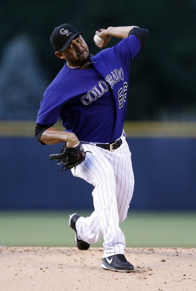 Photo - Colorado Rockies starting pitcher Franklin Morales throws to the plate against the Washington Nationals during the first inning of a baseball game on Monday, July 21, 2014, in Denver. (AP Photo/Jack Dempsey)