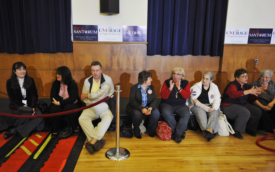 Photo - Rick Santorum supporters wait for his arrival, before a South Carolina primary-night rally at The Citadel in Charleston, S.C., Saturday, Jan. 21, 2012. (AP Photo/Rainier Ehrhardt) ORG XMIT: SCRE104