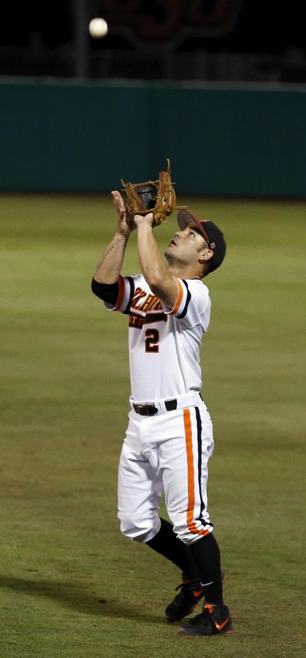 Photo - OSU's Tim Arakawa (2) catches a fly ball  during Game 1 of the NCAA baseball Stillwater Super Regional between Oklahoma State and UC Irvine at Allie P. Reynolds Stadium in Stillwater, Okla., Friday, June 6, 2014. Photo by Nate Billings, The Oklahoman