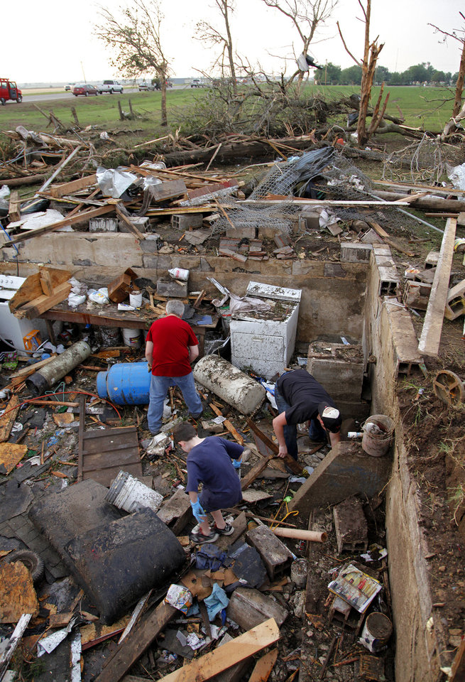 Friends and family dig through the debris left behind after a tornado destroyed the home of Tom Chronister north of El Reno, Tuesday, May 24, 2011. Photo by Chris Landsberger, The Oklahoman ORG XMIT: KOD