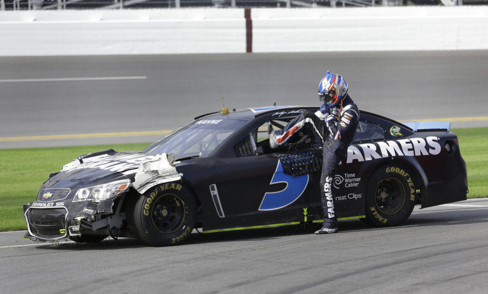Kasey Kahne climbs out of his car on pit road after he was involved in a wreck during NASCAR auto race testing at Daytona International Speedway, Friday, Jan. 11, 2013, in Daytona Beach, Fla. (AP Photo/John Raoux)