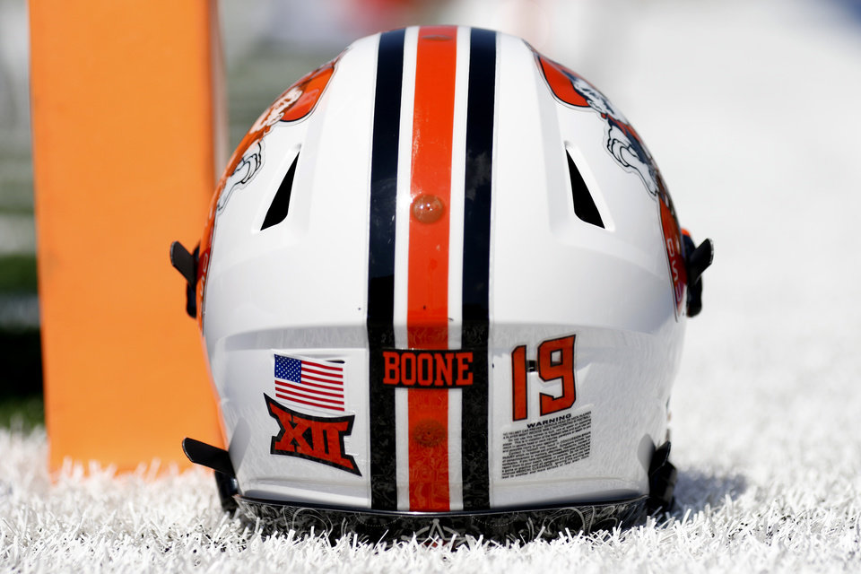 Photo - An OSU helmet is pictured with a sticker honoring T. Boone Pickens during a college football game between the Oklahoma State University Cowboys (OSU) and the University of Tulsa Golden Hurricane (TU) at H.A. Chapman Stadium in Tulsa, Okla., Saturday, Sept. 14, 2019. [Sarah Phipps/The Oklahoman]