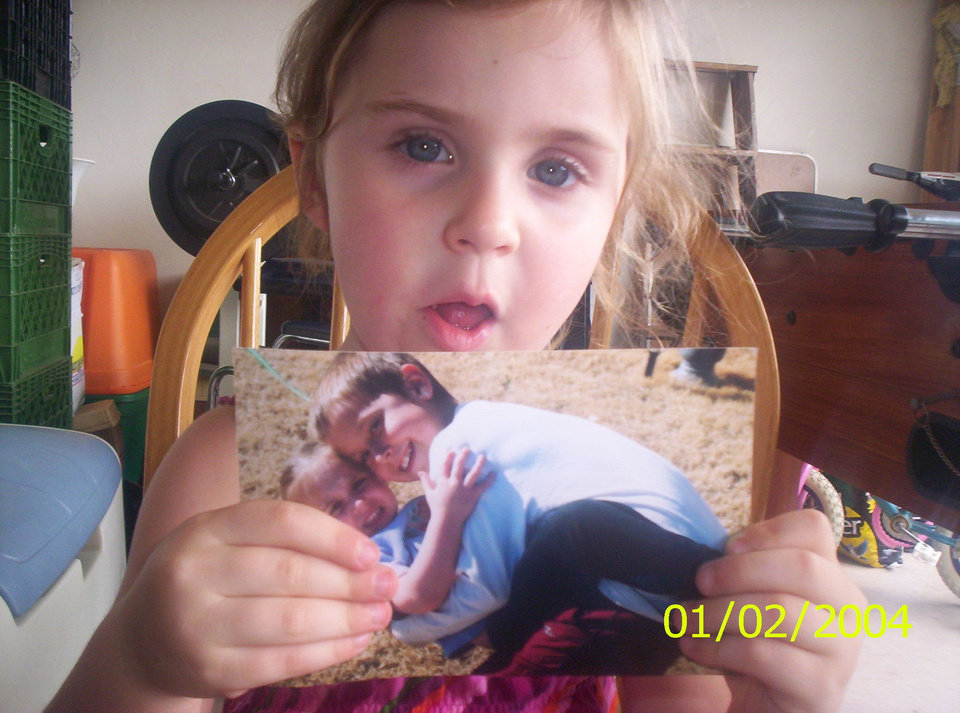 Alysia holding her picture of Kash and her... she is 4<br/><b>Community Photo By:</b> Tama<br/><b>Submitted By:</b> Tama, Midwest