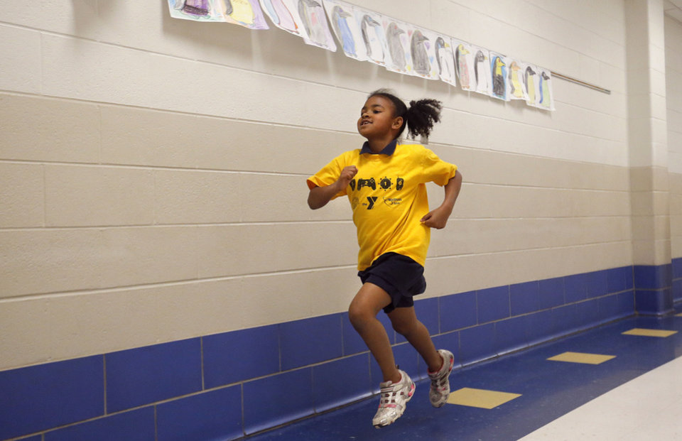 Mykal Ogans runs with the girls running club at Martin Luther King Elementary in Oklahoma City.Photo by Sarah Phipps, The Oklahoman <strong>SARAH PHIPPS - SARAH PHIPPS</strong>