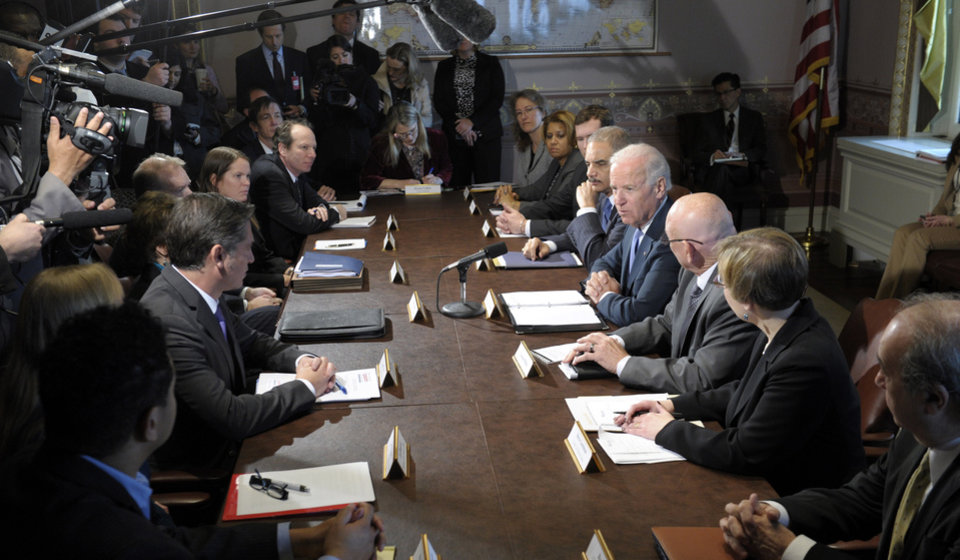 Photo - Vice President Joe Biden, fourth from right, with Attorney General Eric Holder at his left, speaks during a meeting with victim's groups and gun safety organizations in the Eisenhower Executive Office Building on the White House complex in Washington, Wednesday, Jan. 9, 2013. Biden is holding a series of meetings this week as part of the effort he is leading to develop policy proposals in response to the Newtown, Conn., school shooting (AP Photo/Susan Walsh)