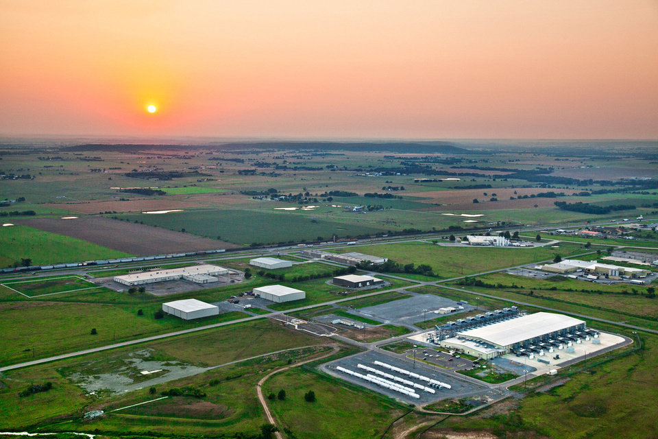 Photo - A sunset highlights this aerial view of Google's data center in Pryor.