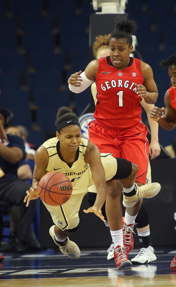 Photo - Vanderbilt guard Christina Foggie (10) dives for a rebound in front of Georgia guard Khaalidah Miller (1) in the second half of a second-round women's Southeastern Conference tournament NCAA college basketball game Thursday, March 6, 2014, in Duluth, Ga.  Georgia won 53-43. (AP Photo/Jason Getz)
