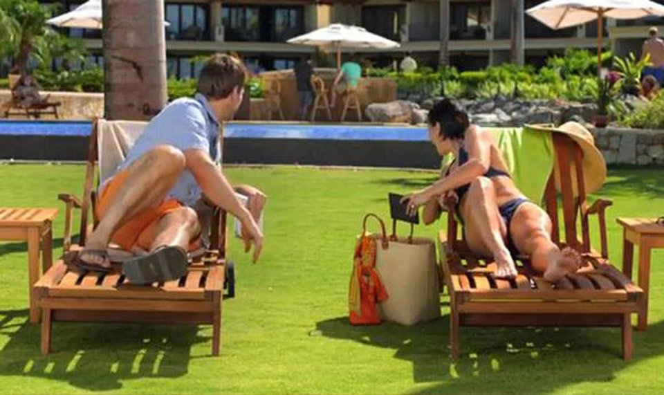This image from video shows an image from a Kindle Paperwhite commercial featuring a young woman on a beach vacation lounging next to a  young man, waiting for their husbands, shown in the background at the bar. Welcome to the latest in gay imagery in mainstream advertising, where LGBT people have been waiting for a larger helping of fairness and accuracy, on screen and in print. Traditionally lagging behind TV and film content in terms of LGBT inclusion, advertisers in this country are suffering considerably less blowback for the effort. (AP Photo/Amazon)