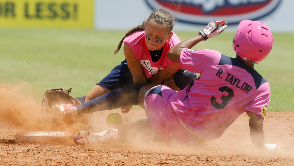 Photo - USA's Rhea Taylor slides to second base as Meike Witteveen of the Netherlands drops the ball in the fifth inning of a the World Cup of Softball game between Team USA and the Netherlands at ASA Hall of Fame Stadium in Oklahoma City, Saturday, June 30, 2012. USA won 2-1. Photo by Bryan Terry, The Oklahoman