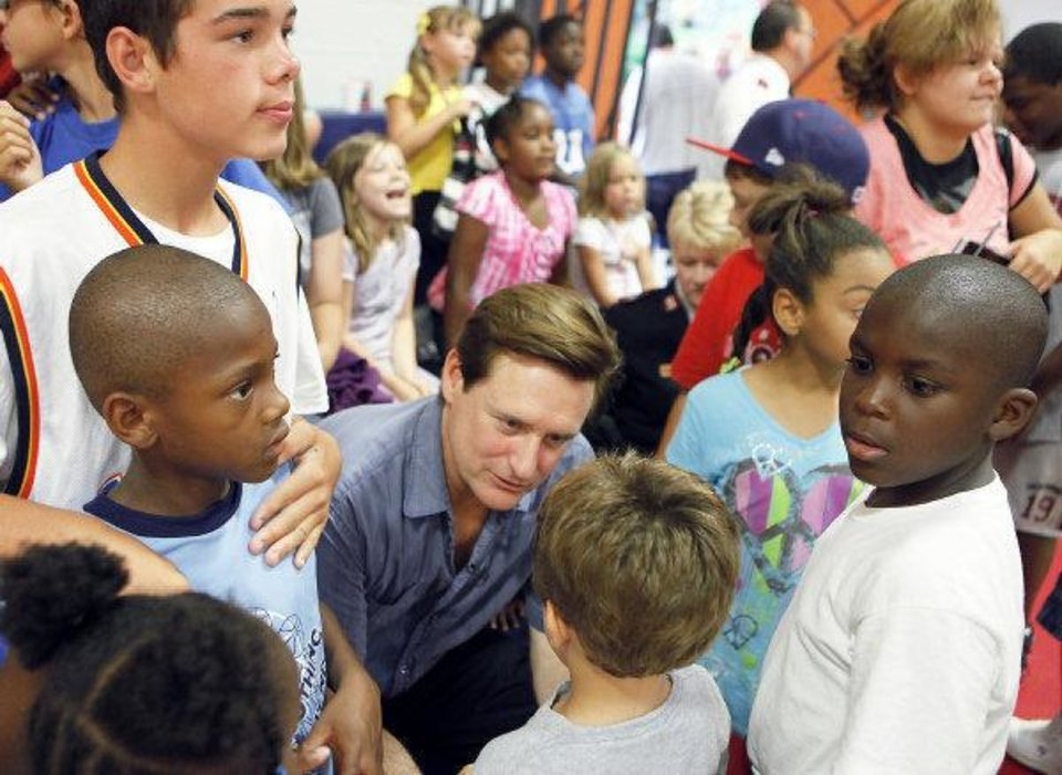 Photo - Actor Bill Pullman, center, speaks with children at the Salvation Army Boys and Girls Club in southwest Oklahoma City, Wednesday, August 4, 2010.     Pullman is in town working on the movie