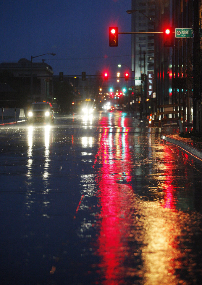 Photo - Rain covered streets before sunrise looking north up Hudson from Park Avenue in Oklahoma City Wednesday, April 10, 2013. Photo by Paul B. Southerland, The Oklahoman