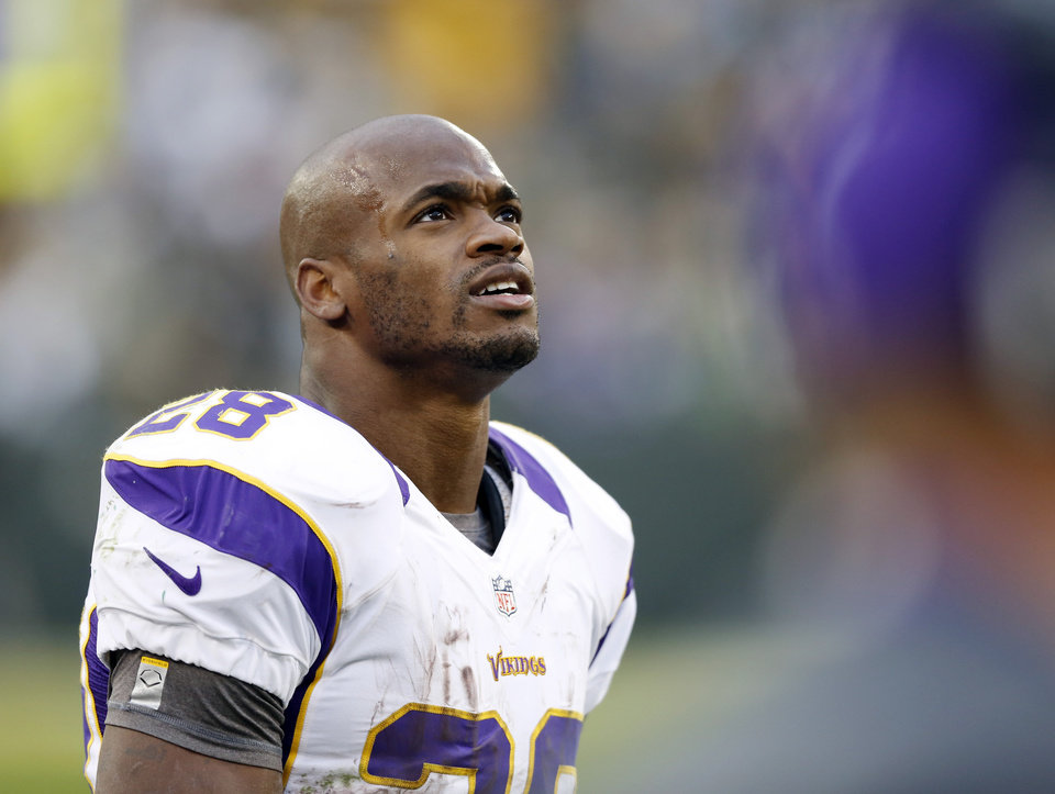 Minnesota Vikings running back Adrian Peterson looks up to the scoreboard toward the end of the second half of an NFL football game against the Green Bay Packers Sunday, Dec. 2, 2012, in Green Bay, Wis. The Packers won 23-14. (AP Photo/Tom Lynn)