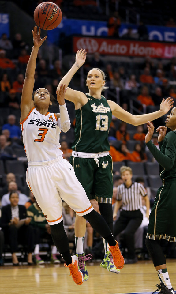Oklahoma State's Tiffany Bias (3) goes to the basket past South Florida's Inga Orekhova (13) during the All-College Classic women's basketball game between Oklahoma State University and South Florida at Chesapeake Energy Arena in Oklahoma City, Okla., Saturday, Dec. 14, 2013. Photo by Bryan Terry, The Oklahoman