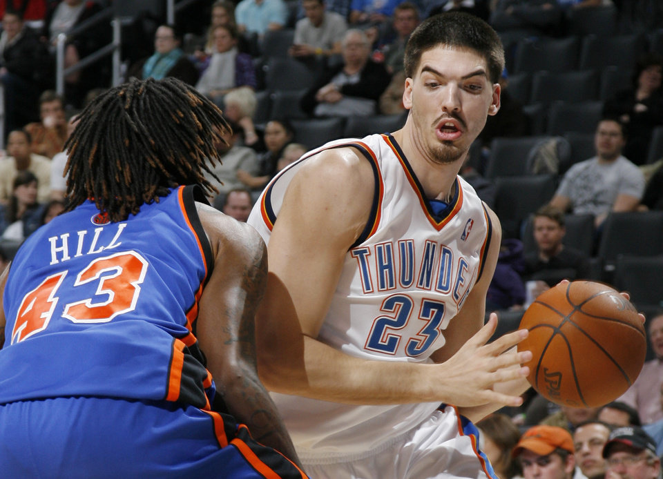 Thunder center Byron Mullens tries to dribble around New York's Jordan Hill during a game on Jan. 11. PHOTO BY NATE BILLINGS, THE OKLAHOMAN