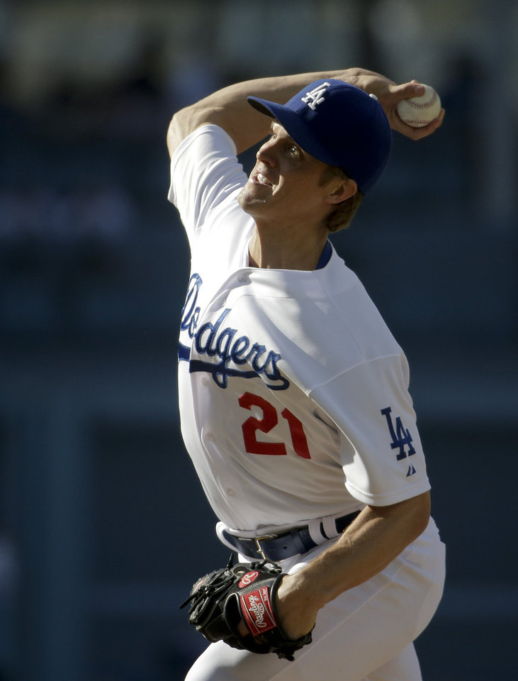 Photo - Los Angeles Dodgers starting pitcher Zack Greinke throws against the Pittsburgh Pirates during first inning of a baseball in Los Angeles, Sunday, June 1, 2014. (AP Photo/Chris Carlson)