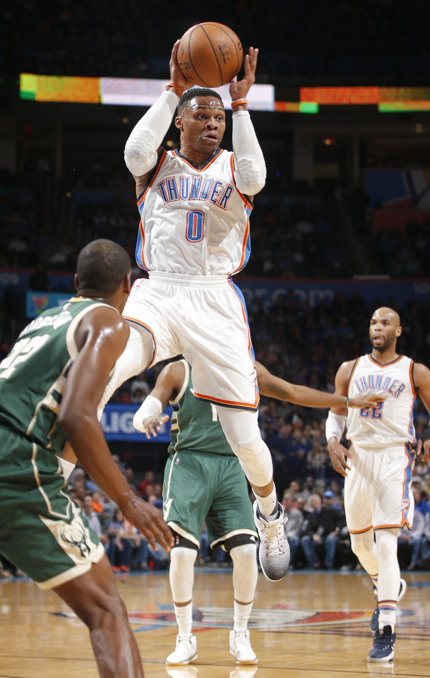 Photo - Oklahoma City's Russell Westbrook (0) passes the ball during an NBA basketball game between the Oklahoma City Thunder and the Milwaukee Bucks at Chesapeake Energy Arena in Oklahoma City, Tuesday, April 4, 2017. Photo by Bryan Terry, The Oklahoman