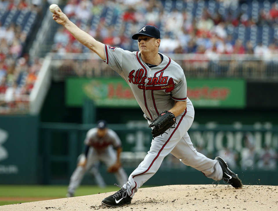 Photo - Atlanta Braves starting pitcher Gavin Floyd throws during the first inning of a baseball game against the Washington Nationals at Nationals Park Thursday, June 19, 2014, in Washington. (AP Photo/Alex Brandon)