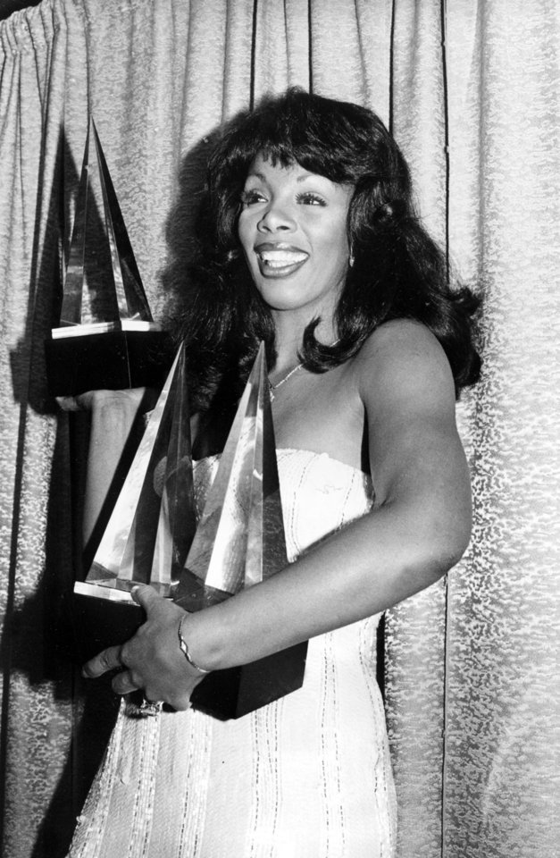 "Photo -   FILE - In this Jan. 12, 1979 file photo, singer Donna Summer poses with three awards she won at the American Music Awards in Los Angeles, Calif. Summer, the Queen of Disco who ruled the dance floors with anthems like ""Last Dance,"" ""Love to Love You Baby"" and ""Bad Girl,"" has died. Her family announced her death in a statement Thursday, May 17, 2012. She was 63. (AP Photo/Nick Ut, File)"