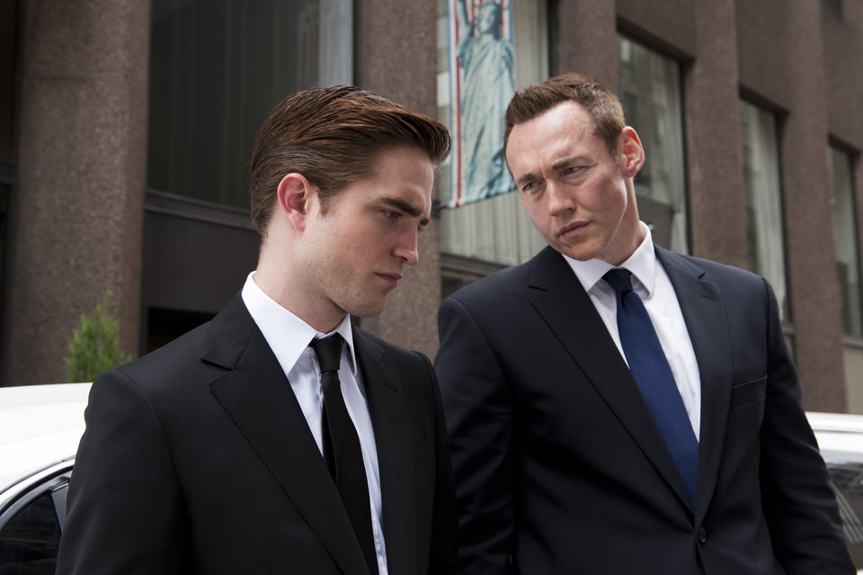 "FILE - This undated publicity film image released by Entertainment One shows Robert Pattinson, left, and Kevin Durand in a scene from ""Cosmopolis."" (AP Photo/Entertainment One, Caitlin Cronenberg, File)"