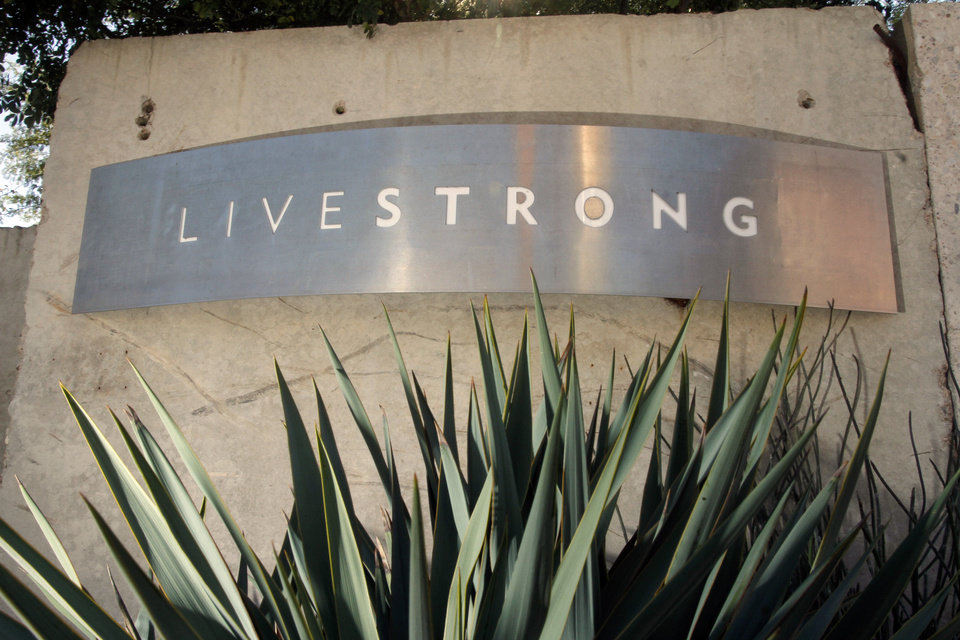 "Signage for the Livestrong Foundation appears at the charity's headquarters, Sunday, Jan. 13, 2013, in Austin, Texas. In what's been billed as a ""no-holds barred"" session, Lance Armstrong is expected to reverse course after a decade of denials and apologize for doping, as well as offer a limited confession about his role at the head of a long-running scheme to dominate the Tour de France with the aid of performance-enhancing drugs, in an interview Monday with Oprah Winfrey. (AP Photo/Jack Plunkett)"